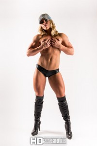 WOW!  The ultimate muscle girl. The gorgeous Tara Suzanne looking amazingly sexy in this hot iWink Studios Shoot!