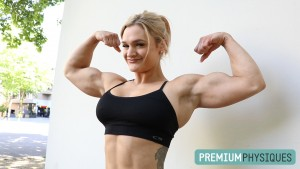 Danielle Mastromatteo confidently shows off her powerful guns - Join PremiumPhysiques for this amazing shoot and countless more!