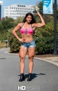 Lucy D flexing hard for you! - JOIN HDPhysiques today for this 21-year-old muscle model specimen!
