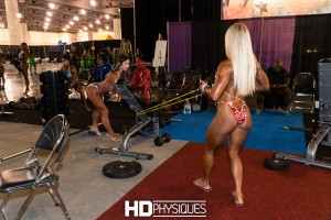 Kristine Duba pumping up her sexy physique backstage getting ready for a showdown with Khadr on the big stage.  Join HDPhysiques now for more behind the scenes coverage!