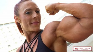 """Katie Lee says - """"go buy my 4K biceps pumping video NOW!""""  Check it out at her Peak Power Studio at the Female Muscle Store, by HDPhysiques.TV!"""